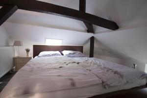 Ein Bett oder Betten in einem Zimmer der Unterkunft Residenz 4 Jahreszeiten