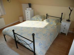 Een bed of bedden in een kamer bij didi logement