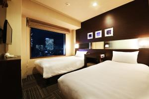 A bed or beds in a room at Shinjuku Prince Hotel