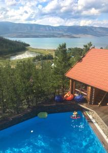 A view of the pool at Villa Baikal Prestige or nearby