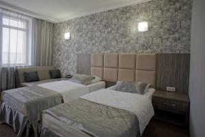 A bed or beds in a room at Hotel Marton Gordeevsky