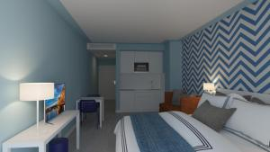 A bed or beds in a room at Terrace Mar Suite Hotel