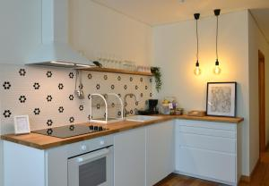 A kitchen or kitchenette at Spot Apartments Sao Bento