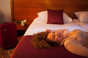Letto o letti in una camera di Hotel Piramida