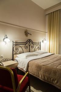 Ένα ή περισσότερα κρεβάτια σε δωμάτιο στο Lido Hotel