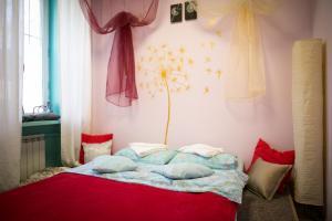 Кровать или кровати в номере Хостел Fusion