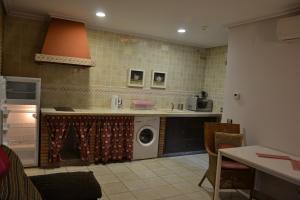A kitchen or kitchenette at Apartamentos Rurales Natura