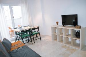Una televisión o centro de entretenimiento en Apartamento Juan de Herrera