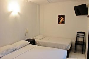 Cama o camas de una habitación en Hotel Villa Colonial By Akel Hotels