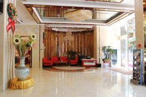 The lobby or reception area at Milu Hotel