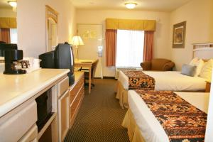 A television and/or entertainment center at Days Inn by Wyndham Rocklin/Sacramento