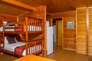 A bunk bed or bunk beds in a room at Snowy River Cabins