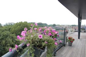Een balkon of terras bij Zicht op de Jachthaven