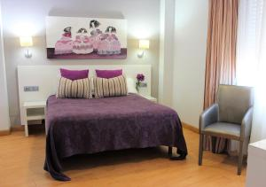 A bed or beds in a room at Hotel Las Olas