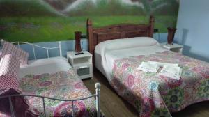 Cama o camas de una habitación en Hotel Rural Casa Indie