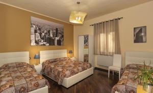 Letto o letti in una camera di Hotel Il Giardino