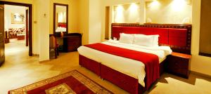A bed or beds in a room at Al Liwan Suites