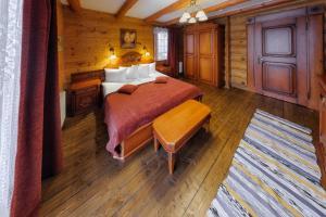 Кровать или кровати в номере Коруна