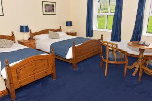 Ein Bett oder Betten in einem Zimmer der Unterkunft An Bothar Pub