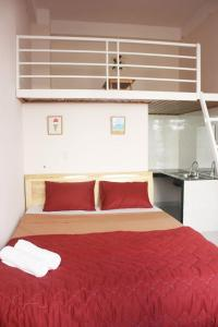 A bed or beds in a room at Tree House Hostel