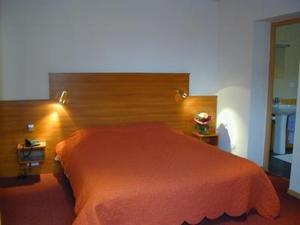 A bed or beds in a room at A L'ancienne Poste