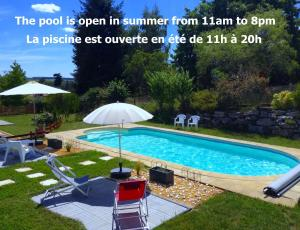 The swimming pool at or near Le Roi Coq