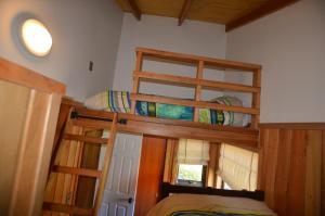 A bunk bed or bunk beds in a room at Cabañas Las Cabras