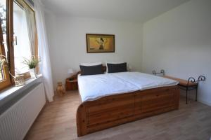 Ein Bett oder Betten in einem Zimmer der Unterkunft Ferienhaus Abendsonne