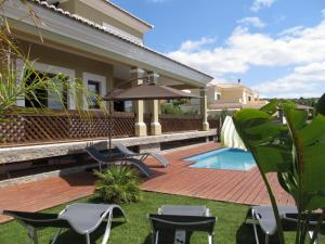 The swimming pool at or near Villa Tiago