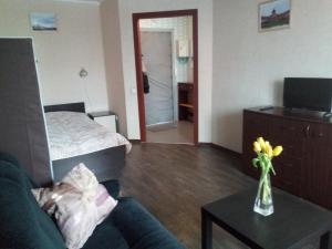 Кровать или кровати в номере Апартаменты на Турку