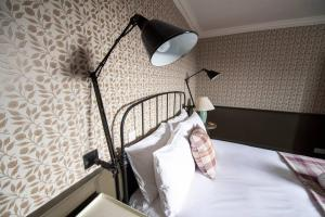 A bed or beds in a room at The Rock House - Historic Gem in the Heart of the City