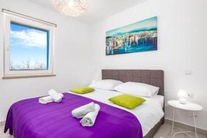 A bed or beds in a room at Olea Residence