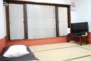 A television and/or entertainment center at Okinawanoyado Ajimaa Makishi