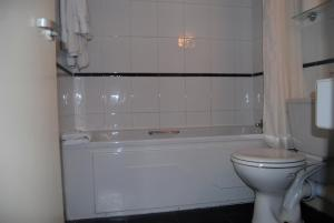 A bathroom at Brecon Hotel Rotherham Sheffield