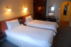 A bed or beds in a room at Brecon Hotel Rotherham Sheffield