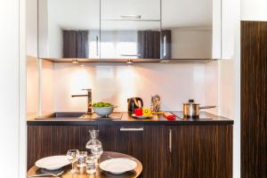 A kitchen or kitchenette at Aparthotel Adagio Marseille Timone