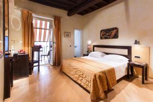 Cama ou camas em um quarto em Hotel De Petris