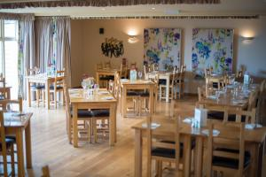 A restaurant or other place to eat at The Poltimore Inn