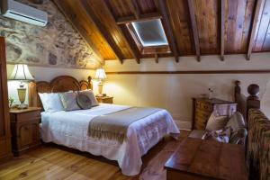 A bed or beds in a room at Clare Valley Heritage Retreat