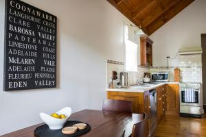 A kitchen or kitchenette at Clare Valley Heritage Retreat