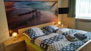 Ein Bett oder Betten in einem Zimmer der Unterkunft Hotel-Pension Dressel