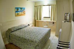 A bed or beds in a room at CHA Klein Ville Inn