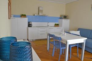 A kitchen or kitchenette at Residenza Diana