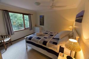 A bed or beds in a room at A Grape Escape