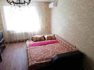 """Кровать или кровати в номере Apartment """"Victoriya"""" on Prospekt Lenina"""