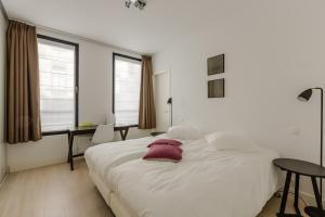 A bed or beds in a room at The Livorno