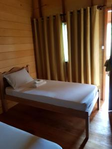 A bed or beds in a room at Amazon Arowana Lodge