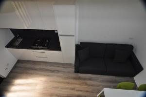 Een keuken of kitchenette bij North Wind Camping & Apartment