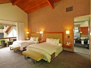 A bed or beds in a room at Aranwa Sacred Valley Hotel & Wellness