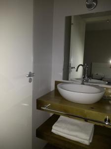 A bathroom at Piavi Residencial